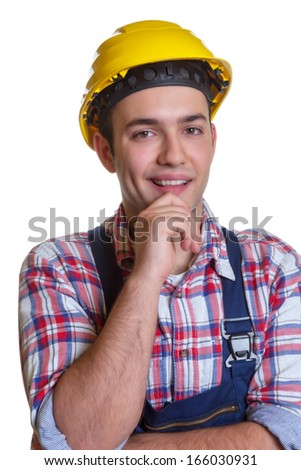 Attractive young construction worker looking at camera - stock photo