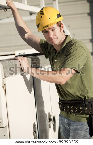 Attractive young construction worker with hardhat