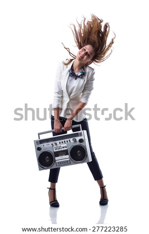 Attractive young cool hip hop dancer with boom box - stock photo