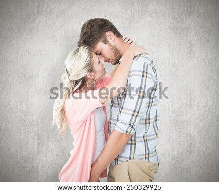 Attractive young couple about to kiss against white background - stock photo
