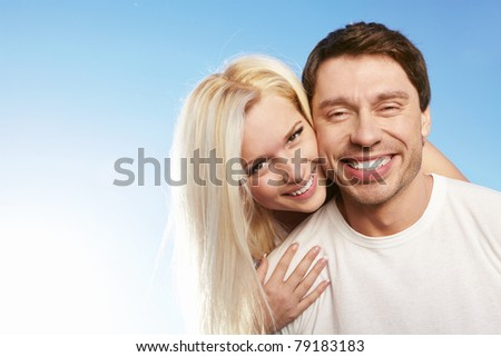 Attractive young couple against the sky - stock photo