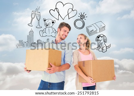 Attractive young couple carrying moving boxes against cloudy sky - stock photo