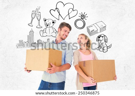 Attractive young couple carrying moving boxes against parchment - stock photo