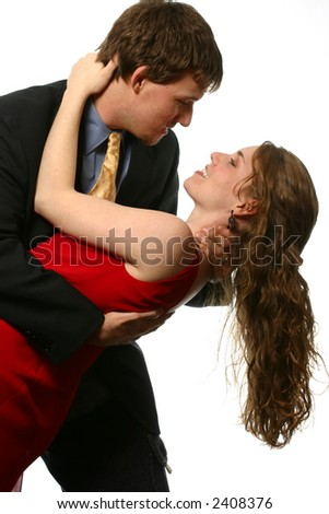 Attractive young couple doing tango - stock photo