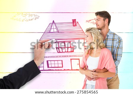 Attractive young couple embracing and smiling against painted blue wooden planks - stock photo