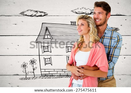 Attractive young couple embracing and smiling against white wood - stock photo