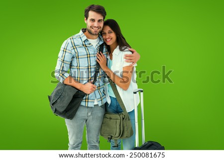 Attractive young couple going on their holidays against green vignette - stock photo