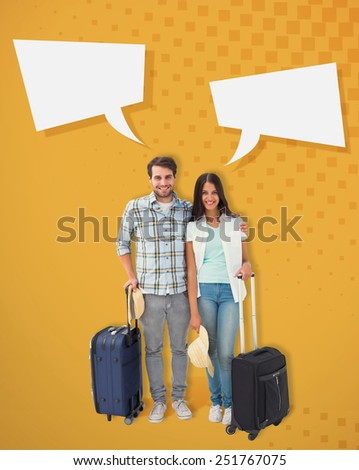Attractive young couple going on their holidays against yellow - stock photo