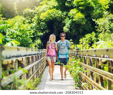 Attractive young couple having fun together outdoors on hike - stock photo