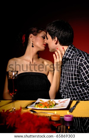 Attractive young couple having romantic dinner - stock photo