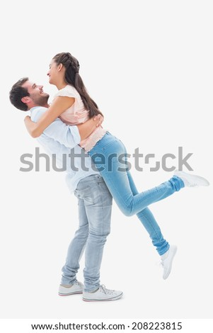 Attractive young couple hugging each other on white background - stock photo