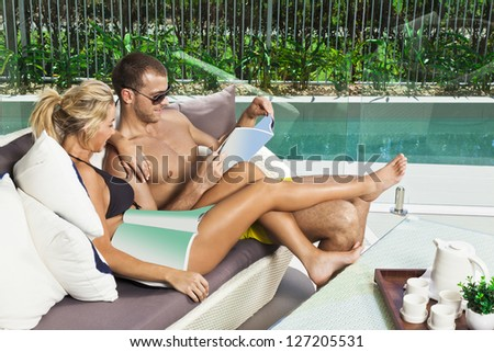 Attractive young couple in backyard patio - stock photo