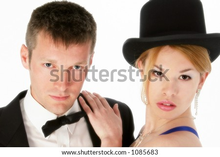 Attractive young couple in formal wear.  Shot in studio over white. - stock photo