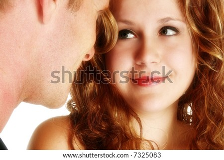 Attractive young couple in formals over white. - stock photo