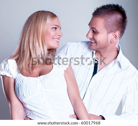 Attractive young couple in romantic relationship  , studio shot - stock photo