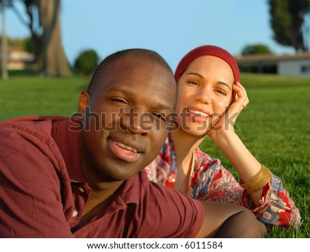 Attractive young couple in the park on a beautiful sunny day - stock photo