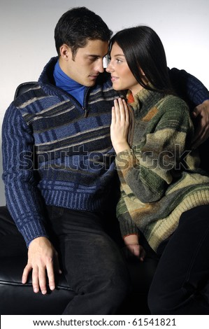 Attractive young couple in the studio - stock photo