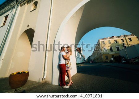Attractive young couple lovely hugging in the city and looking each other. Photo with copy space  - stock photo