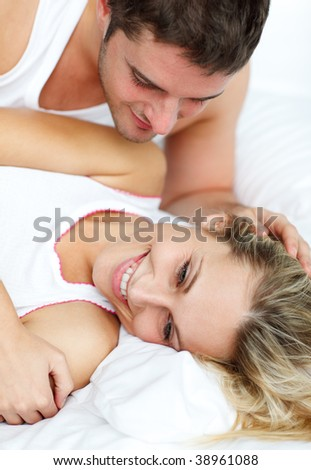 Attractive young couple lying in bed together