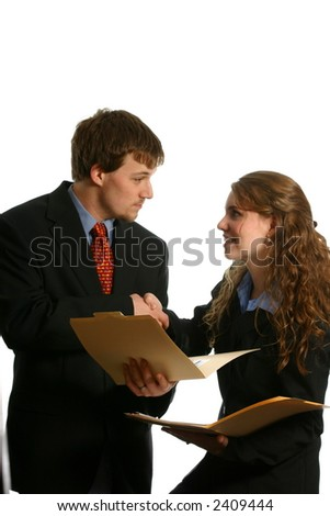 Attractive young couple making business deal - stock photo