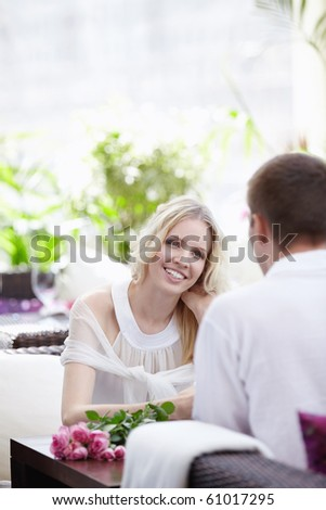Attractive young couple on a date in a cafe - stock photo