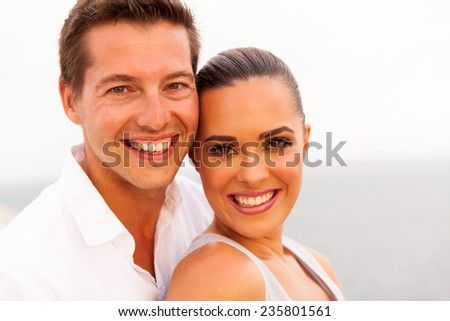 attractive young couple on cruise ship closeup portrait