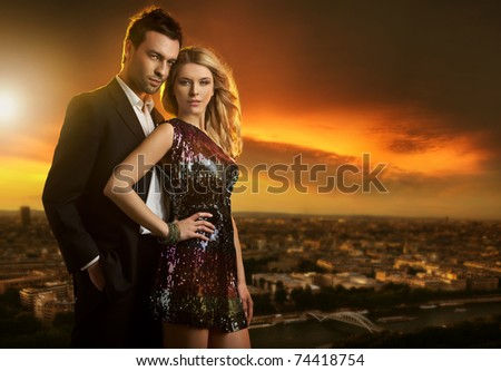 Attractive young couple on the city background - stock photo