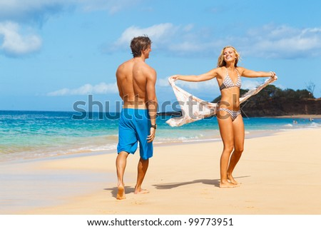 Attractive Young Couple on Tropical Beach