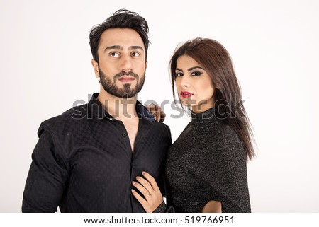 Attractive young couple on white background