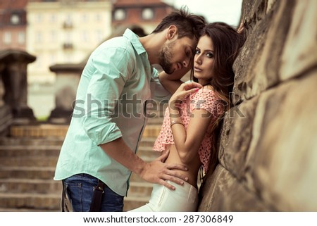 attractive young couple outdoor - stock photo