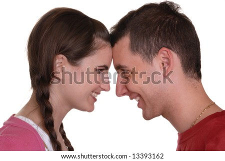 attractive young couple playfully looking into each others eyes - on white