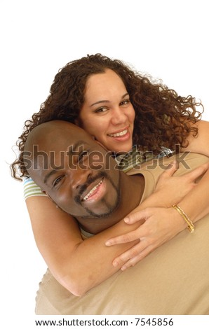 Attractive young couple playing around, laughing and hugging - stock photo