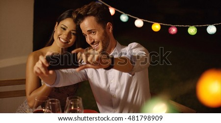 Attractive young couple posing for a selfie