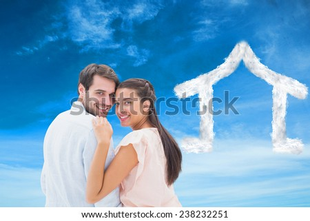 Attractive young couple smiling at camera against blue sky - stock photo