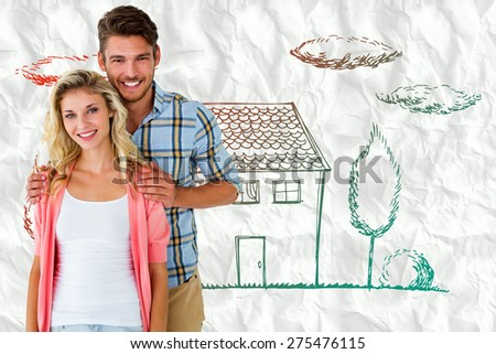 Attractive young couple smiling at camera against crumpled white page - stock photo