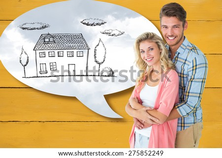 Attractive young couple smiling at camera against grey cloudy sky - stock photo