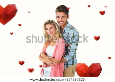 Attractive young couple smiling at camera against hearts - stock photo