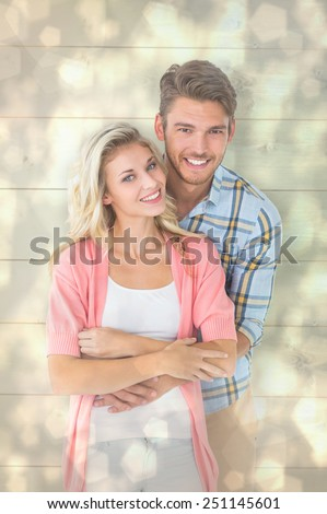 Attractive young couple smiling together against light glowing dots design pattern - stock photo