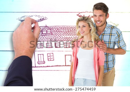 Attractive young couple smiling together against painted blue wooden planks - stock photo