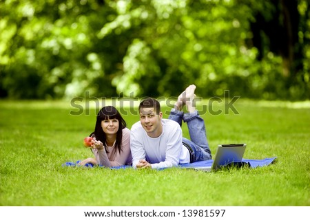 Attractive young couple spending time together outdoors - stock photo