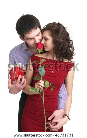 Attractive young couple with a gift and rose in hands isolated on the white background - stock photo