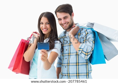 Attractive young couple with shopping bags and credit card on white background - stock photo