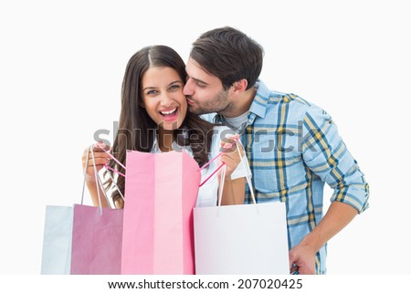 Attractive young couple with shopping bags on white background - stock photo