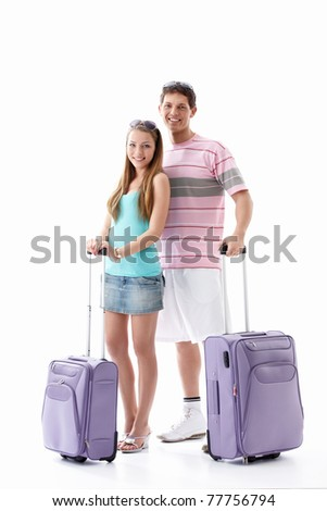 Attractive young couple with suitcases isolated - stock photo