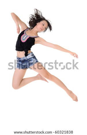 Attractive young dancer jumping and dancing against white background.