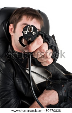 attractive young Europeans in the Caucasus,a black leather jacket,strangled by electric cables leather chair, looks emotionally cord around his neck,a wire around his neck, fork,isolated over white