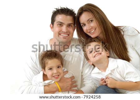 Attractive young family laughing while posing together for a portrait; copy space can be expanded - stock photo