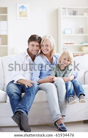 Attractive young family with a child at home - stock photo