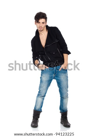 Attractive young fashion model wearing jeans, boots and a black jacket. Isolated on white background. Studio vertical image. - stock photo
