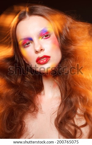 attractive young fashion model with bright art colorful make up fire lights, studio shot for cover magazine - stock photo